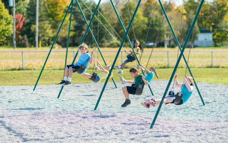 children on swings enjoying extra recess