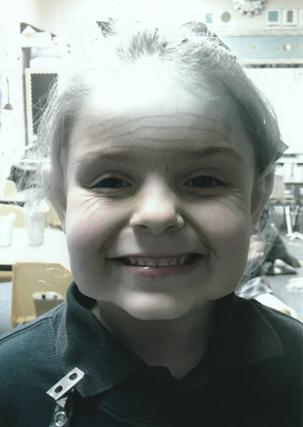 kindergartener with camera filter to make her look 100 years old
